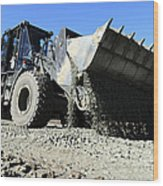 A Front End Loader Raising A Road Bed Wood Print