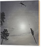 A Helicopter Lifts Cut Timber Wood Print