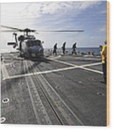 A Helicpter Sits On The Flight Deck Wood Print