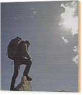 A Hiker Rests Atop A Huge Granite Wood Print