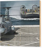 A Hovercraft Approaches Uss New Orleans Wood Print