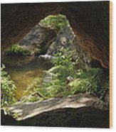 A Huge Hole In Rock With A Water View Wood Print