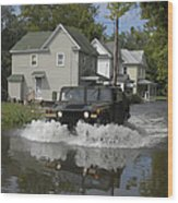 A Humvee Drives Through The Floodwaters Wood Print
