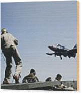 A Jet Lands Onboard An Aircraft Carrier Wood Print by J Baylor Roberts