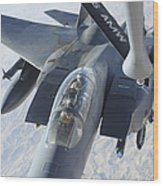 A Kc-135 Stratotanker Refuels An F-15e Wood Print by Stocktrek Images