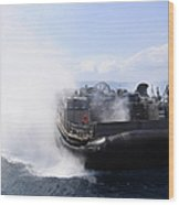A Landing Craft Air Cushion Travels Wood Print