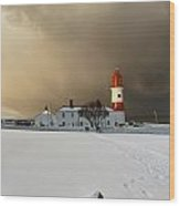 A Lighthouse And Building In Winter Wood Print by John Short