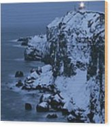 A Lighthouse Atop Snow-covered Cliffs Wood Print