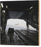 A Loadmaster Guides The Pilot Of A C-17 Wood Print