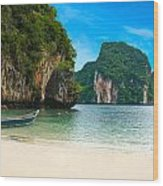 A Long Tail Boat By The Beach In Thailand  Wood Print
