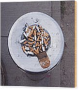 A Lot Of Cigarettes Stubbed Out At A Garbage Bin Wood Print