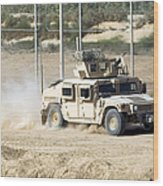 A M1114 Humvee Patrols The Perimeter Wood Print