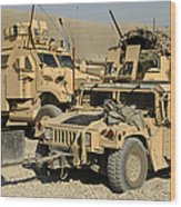 A M1114 Humvee Sits Parked In Front Wood Print
