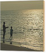 A Man And A Young Boy Fish In The Surf Wood Print