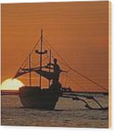 A Man And An Outrigger Silhouetted Wood Print