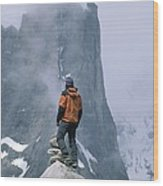 A Man Stands On A Cliff Watching Wood Print