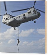 A Marine Fast Ropes From A Ch-46e Sea Wood Print