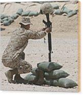 A Marine Hangs Dog Tags On The Rifle Wood Print