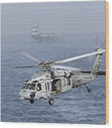 A Mh-60s Knighthawk Conducts A Vertical Wood Print by Gert Kromhout