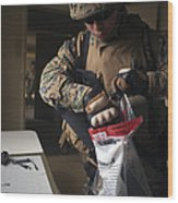 A Military Policeman Collects Materials Wood Print
