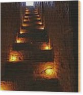A Narrow Staircase Lit With Candles Wood Print