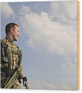A Paratrooper Looks On As Other Wood Print