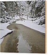 A Partially Frozen Stream Runs Wood Print