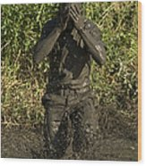 A Participant Wipes Mud From His Face Wood Print