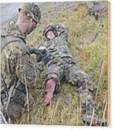 A Patrol Medic Applies First Aid Wood Print
