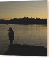 A Photographer At Work During Sunset Over A Lake Wood Print