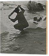A Photographer Processes Film Among Ice Wood Print