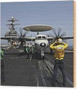 A Plane Director Guides An E-2c Hawkeye Wood Print