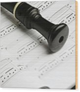 A Recorder Lying On A Book Of Sheet Music Wood Print by Studio Blond