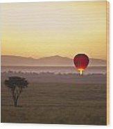 A Red Hot Air Balloon Takes Flight Wood Print