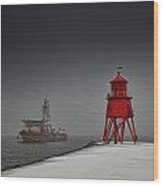 A Red Lighthouse Along The Coast In Wood Print