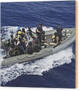 A Rigid-hull Inflatable Boat Carrying Wood Print by Stocktrek Images
