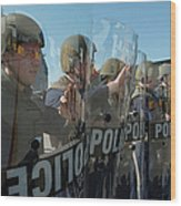 A Riot Control Team Braces Wood Print by Stocktrek Images