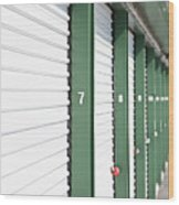 A Row Of Locked Storage Units At A Self Storage Facility Wood Print by Frederick Bass