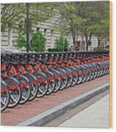 A Row Of Red Bikes Wood Print