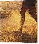 A Runner Splashing Through The Surf Wood Print