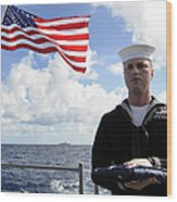 A Sailor Carries The National Ensign Wood Print