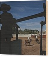 A Silhouetted Cowboy Watches Riders Wood Print
