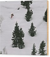 A Skier Makes His Way Down A Hill Wood Print