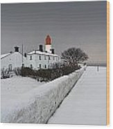A Snow Covered Fence With A Lighthouse Wood Print by John Short