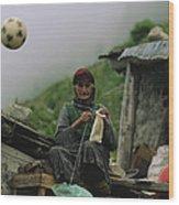 A Soccer Ball Flies Over The Head Wood Print