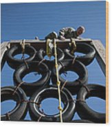 A Soldier Climbs Over A Tire Tower Wood Print