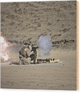 A Soldier Fires A Rocket-propelled Wood Print