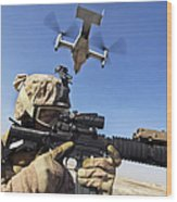 A Soldier Provides Security As An Mv-22 Wood Print