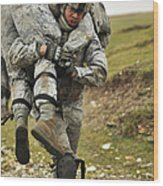 A Soldier Transports A Fellow Wounded Wood Print
