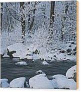 A Stream Running Through Snowy Woodland Wood Print